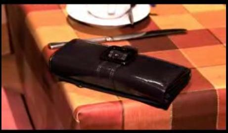 A purse or wallet left on a table.