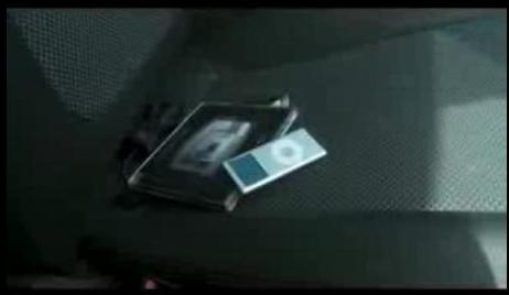 An image of valuables left on show inside a vehicle.