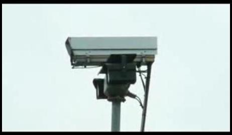 An image of a security camera in operation at a secure car park.