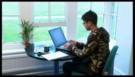 A typical student working on his laptop