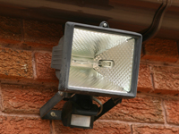 A security light fitted to a house.