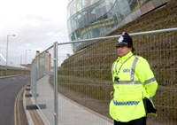 A police officer standing next to a cordon